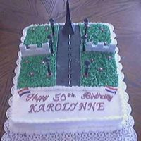 Karolynne's Birthday The cake is marble, with BC. The Eiffle Tower and wall is made with fondant.