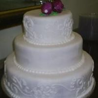 Dress Matching Wedding Cake The piping on this cake was done to match the design on the bride's dress.