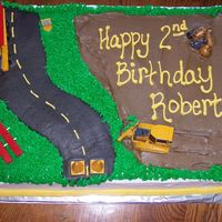 Construction Cake Made this for my son's 2nd birthday, it was a construction theme. It was my first 12x18 using the super enhanced recipe from here.