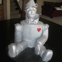 The Tin Man RKT head, arms legs. Cake body, all covered in fondant. Gumpaste funnel hat.