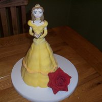 Belle From Beauty And The Beast  My daughter's 3rd birthday cake, Belle. Ill be the first one to say it, get that girl a big mac and a sun tan. She was extreemly...