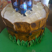 21St Birthday Cake Beer bottles are real. Ice is made from clear candy mix. The rest is fondant.