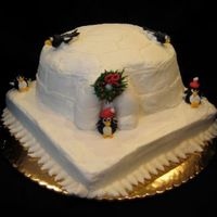 "Igloo Cake I0"" square with upside down bundt cake. All butter cream including penguins and wreath."