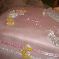 A Girl's On The Way White cake layered with lemon filling and iced in pink fondant. Adorned with the stork and a few necessities (in pink) which an expectant...