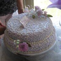 Lavender And Lace This lacy creation was iced in lavender fondant and finished with a cornelli lace pattern and a small spray of carnations. It celebrated a...
