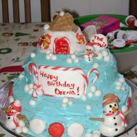 Christmas Cake This was for a lady that is like me second mom. Her birthday is the 24th,Its a carrot cake on the bottom and spice cake on top. MMF...