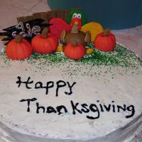 My First Thanksgiving Cake Spice cake (recipes found on here) with cream cheese icing, fondant pimkin and turkey etc.