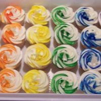 Rainbow Cupcakes Well I just let my imagination run wild w/these. Made them just for fun. White cake iced w/buttercream.