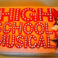 High School Musical This cake was a copied design from a little girl's room decor. It's white cake iced w/buttercream w/fondant accents.