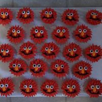 Elmo Cupcakes All iced w/buttercream. I used a star tip and pulled it out a bit for more fuzzier hair. The rest was piped on.