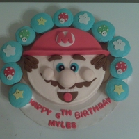 Myles Mario Bday Cake cake and cupcakes covered in condant w/fondant accents...he loved it :-)