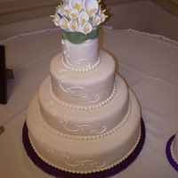 1St Wedding Cake Fondant covered chocolate/raspberry, white/raspberry, lemon poppy seed. Gumpast calla lilies.