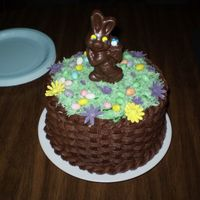 "Easter Basket buttercream basket weave, coconut ""grass"", fondant and royal flowers, candy eggs and bunny."