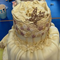 Couture This is the latest cake i've completed for my Level 2 Sugarcraft Course. The remit of the cake was to include swags/drapes, lace...