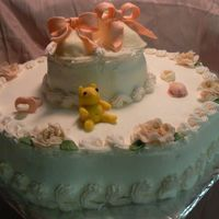 Baby Shower Chocolate cake with BC icing. My first gum paste booties, bear, sock monkey, & flowers.