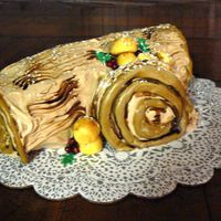 Yule Log Cake Pumpkin Roll with Cream Cheese filling & Mocha BC icing. Fondant berries, leaves & mushrooms. Dusted with PS.