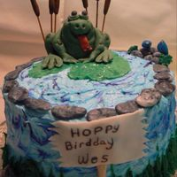 Frog In Pond Apple Spice cake with apple cinnamon BC icing. Frog, cattails, birds, rocks are Fondant/gumpaste, the lily pad is white chocolate fondant....
