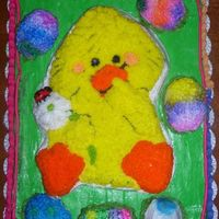 Easter Cake And Cookie Cake duck and eggs on top of a giant cookie