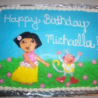 100_2008.jpg Dora The Explorer Cake, dora and boots are fondant