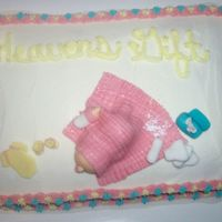 Baby Shower Cake fondant baby,blanket,bottle,diapers,baby powder bottle, wipes. baby powder is powdered sugar
