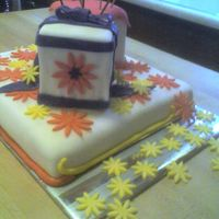 Present Cake 2 small cakes on 1 sheet cake all decorations in fondant