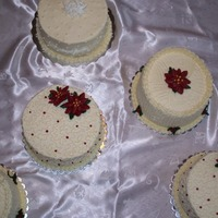 "Simple Christmas Cakes 6"" Christmas cakes decorated with buttercream icing and buttercream flowers. Dark & light fruit cake, cherry cake, apricot raisin..."
