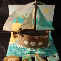Ahoy Mate Baby Shower Cake made to match the Ahoy Mate line of bedding. Monkey and parrot made of modeling chocolate, treasure chest made of chocolate, sails...