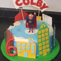 Superman A version of a cake that my client emailed to me to recreate with a few requested changes. Cake is in BC with gumpaste and fondant...