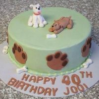 Puppies Cake frosted in BC with fondant paw prints and bones. Gumpaste puppies, these were my very first molded gumpaste figures - and I can't...