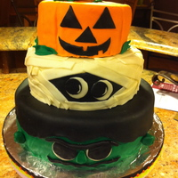 Halloween Cake This is a 3 tiered cake marble with buttercream donated to a very worthy charity organization. This cake is DIRECTLY taken from one cake in...
