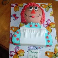 Raggedy Ann Cake for a friend's sister. Sports ball half on a 6 inch round for head. Body is 9 inch cake cut in half and stacked. Made a little...