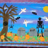"Halloween This is a 12""X15"" single layer vanilla sheet cake tinted orange. Iced and decorated with butter cream. Dirt under tombstones is..."