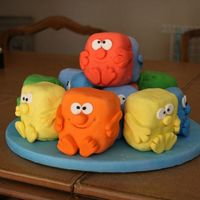 Mini Monsters Mini Monster cakes covered with fondant.