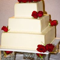 My First Wedding Cake!  I made this wedding cake for my cousin's wedding. I had never done a wedding cake bafore so I learned everything from all of you and...