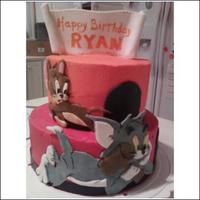 Tom & Jerry tiered cakes with fondant cutouts of tom & jerrry