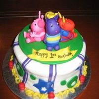 Backyardigans First Birthday Backyardigans cake for a little boy's first birthday. White cake with white buttercream frosting. All figures are gumpaster/fondant...