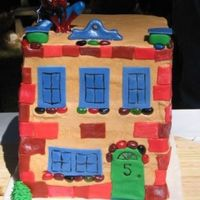 Spiderman Building So this cake was for a Spiderman birthday party for a 5 year old...The party was all superhero and so they wanted an understated spiderman...