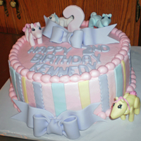 "My Little Pony 10"" buttercream cake with fondant decorations. Little ponies were also madeof fondant."