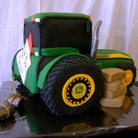 John Deere Tractor The bride wanted to surprise her future husband with a cake to match his tractor. Tires are RKT and entire cake is covered in fondant.