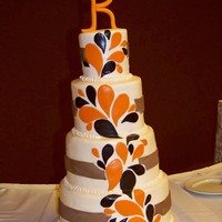 "Paisley Splash Wedding 4"", 6"", 8"", and 10"" round tiers covered with buttercream frosting and fondant decorations. ""K"" was made with..."