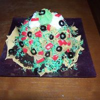 Taco Salad Cake The chocolate cake was baked in a Wilton wonder mold pan. The top was cut off and crumbled to place around the edges for ground beef. The...