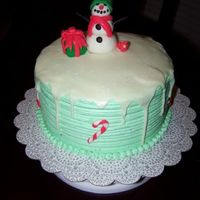 "Mint Chocolate Snow Chocolate cake with creme de menthe buttercream, fondant snowman and characters. ""Snow"" is thinned buttercream with crystal..."