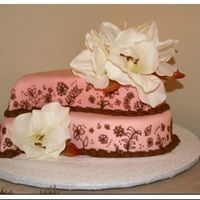 Pink Paisley My version of a cake in Wilton's. For my sister's bridal shower. The theme and decor was pink and brown paisley. Instead of using...