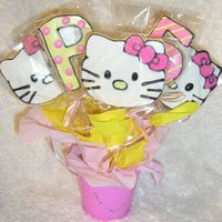 Hello Kitty Cookie Bouquet These were for a 5th birthday. Thanks to Carmie00 for the Hello Kitty idea!NFSC with my variation of Alice's Cookie Icing. For some...