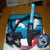 Hockey Duffle Gym Bag Birthday Cake This cake is for my son's 3rd birthday. He wanted a goalie theme. The helmet skates and stick are made of rice crispies and fondant....
