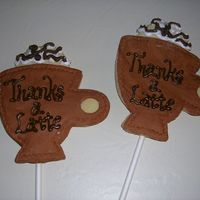Thanks A Latte!  These are cookies on a stick that I made as a thank you. They are coffee cup shaped cookies with MMF and royal accents. I will shrink wrap...