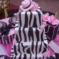 Zebra Cake This cake was the centerpiece for a table design luncheon. I got inspiration from some plates and napkins. The hat on top goes with the...