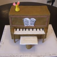 Piano Covered with buttercream, fondant accents