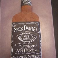 Jack Daniels Bottle This is covered in buttercream. The label is fondant and I hand wrote all the words on the label.