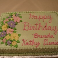 Floral Birthday Cake  I made this for a work birthday get together. The flowers are made of royal icing. I wanted something different than white icing so I...